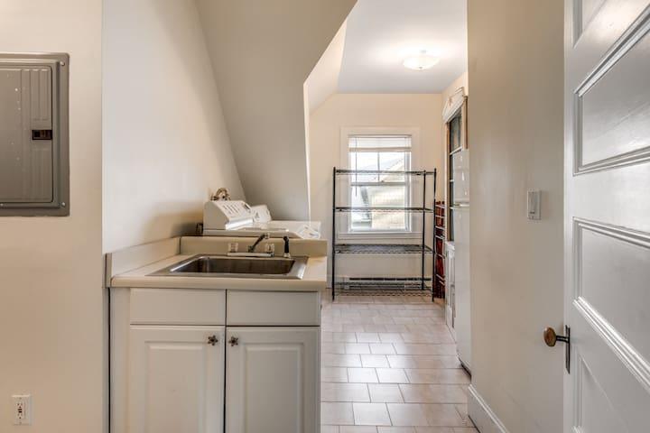 Large laundry room on upper level