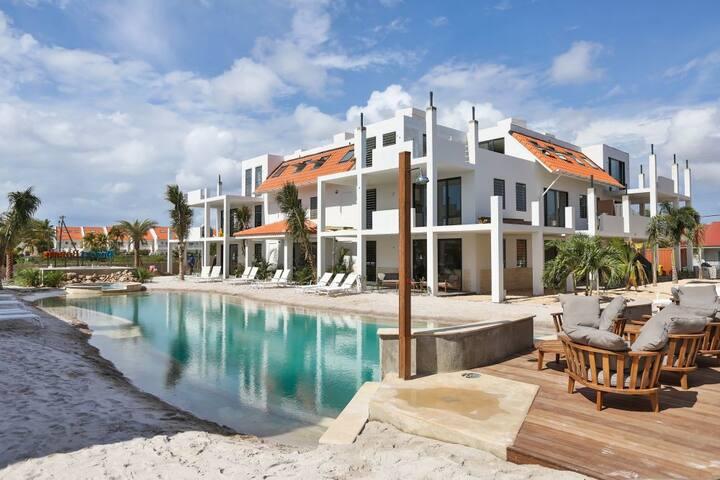 Spacious 1BR Apt w Pool & Sea Views