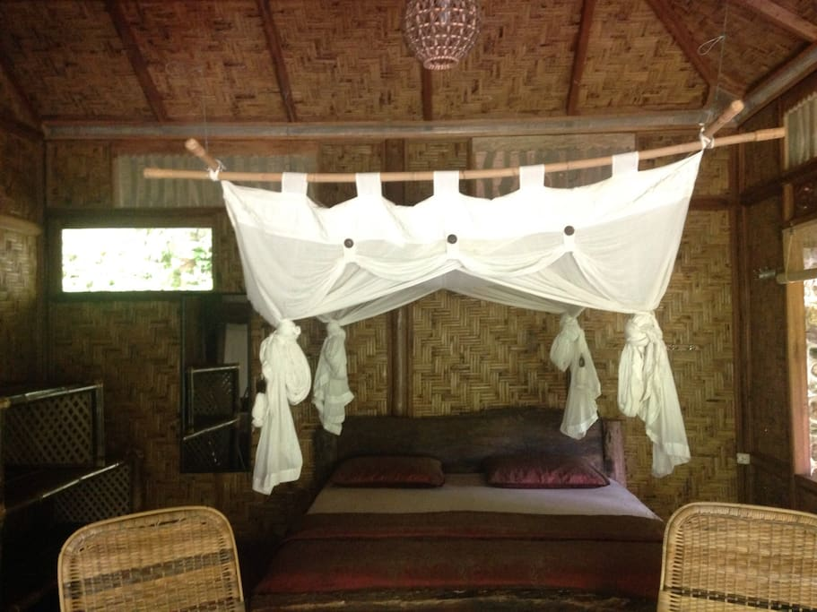 King-size bed with mosquito net