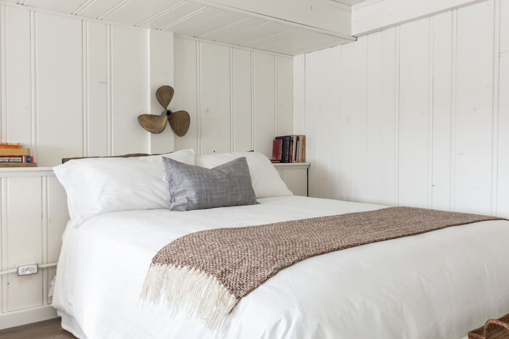 Queen-sized bed with view across your private beach deck to the ocean.