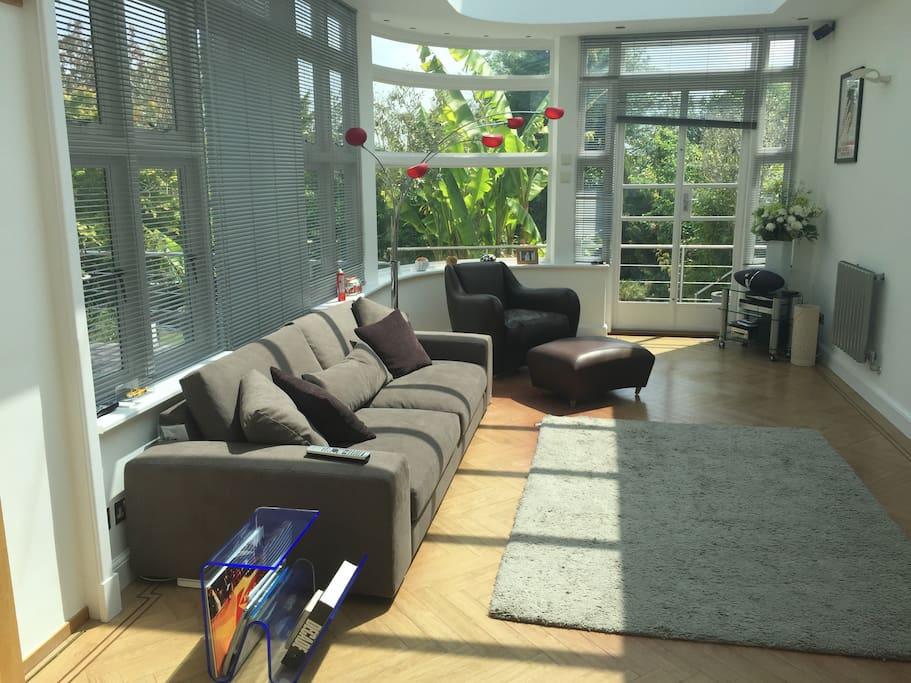 Main reception area/garden room. contemporary and very bright spacious room. Patio door access to rear garden.