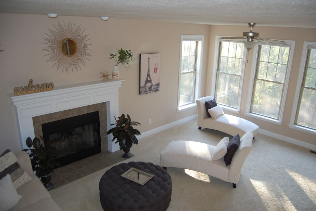 Large living room with an abundance of natural light!