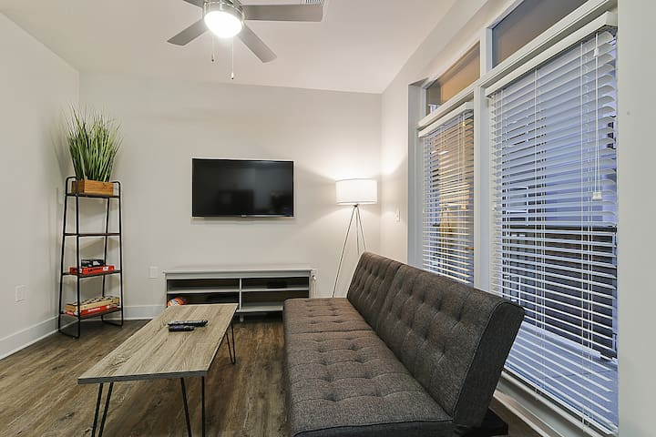 Living room comes with 50 inch Smart TV, WiFi and Cable. You'll also have access to your own walk out balcony.