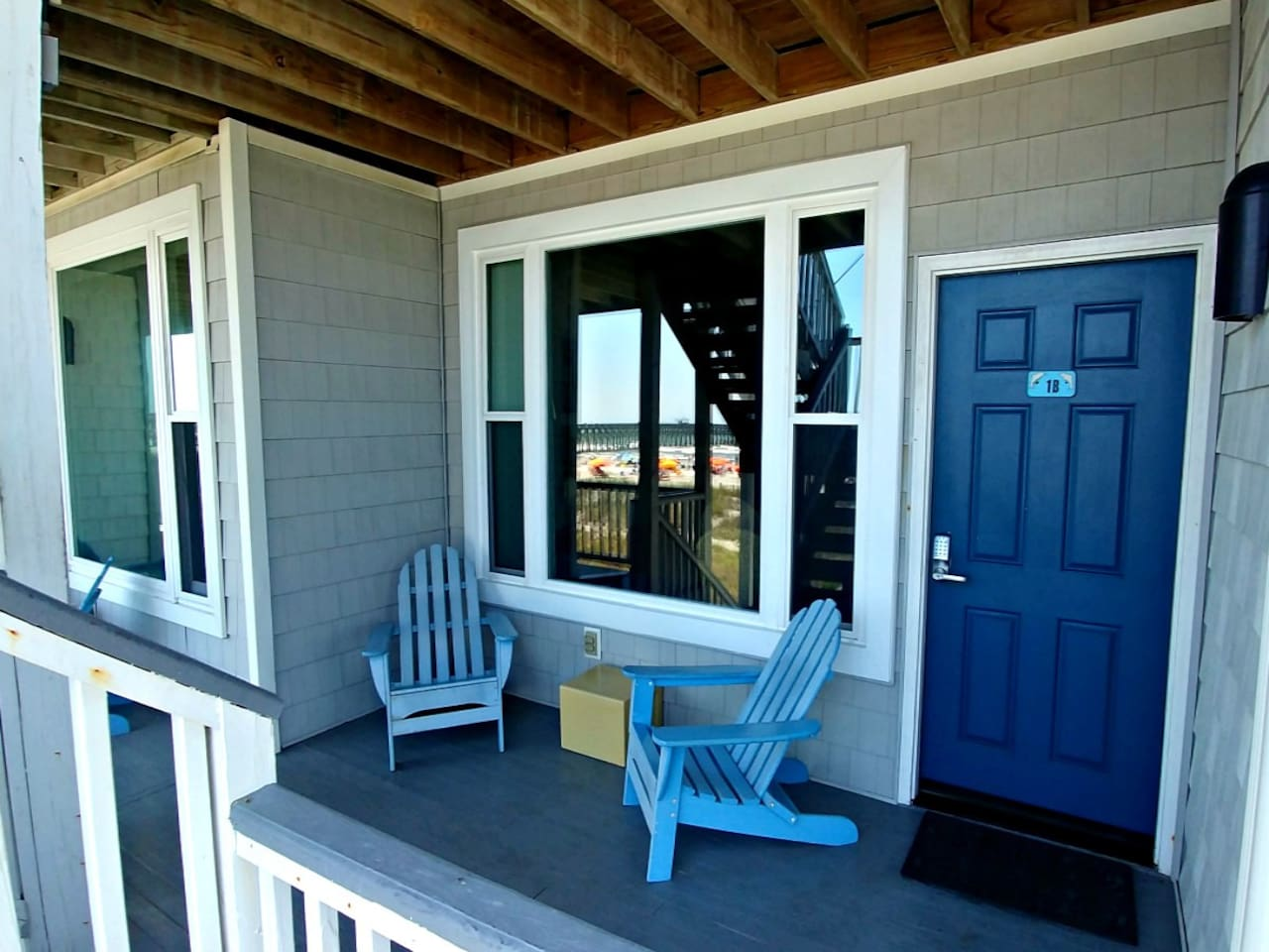 Front Porch. The stairs are located directly in front of the porch