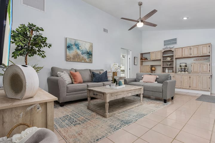 """Second living area with 65"""" smart TV and queen size sofa bed."""
