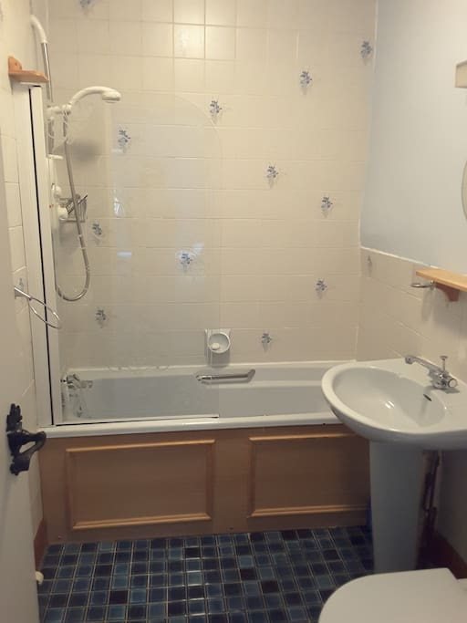 En suite with bath, shower and toilet