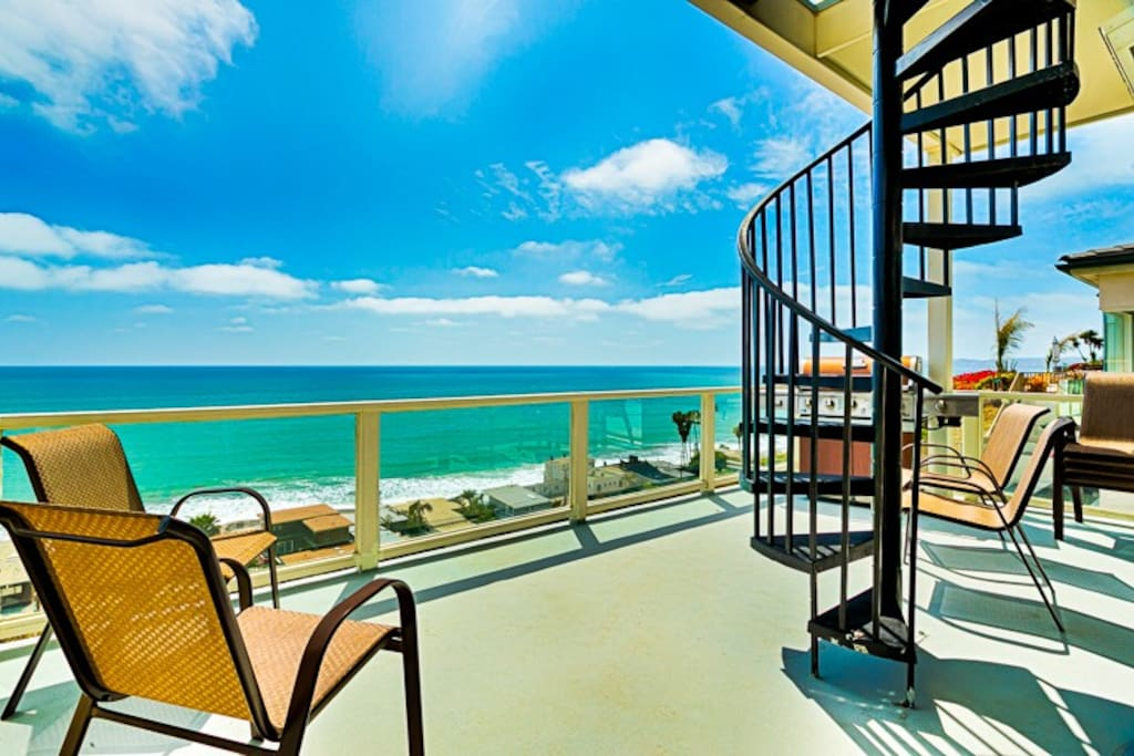 Enjoy the view or BBQ on the second floor deck or simply take the stairs up to the roof top deck for even more unobstructed view