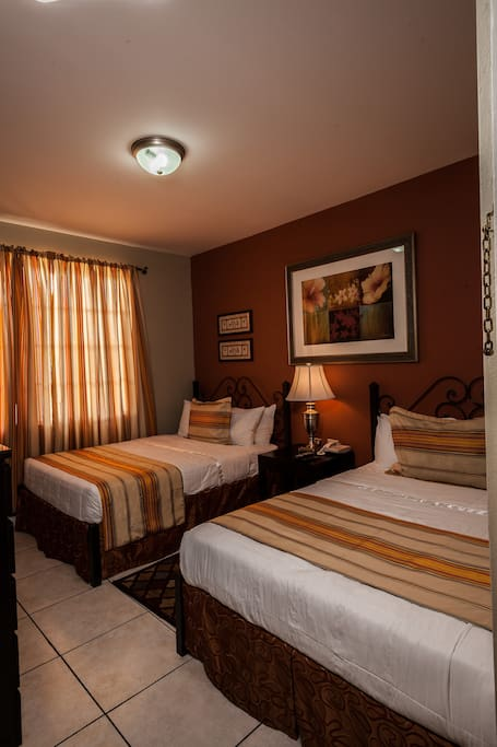 Superior Room with 2 double beds. Sleeps up to 4 persons.