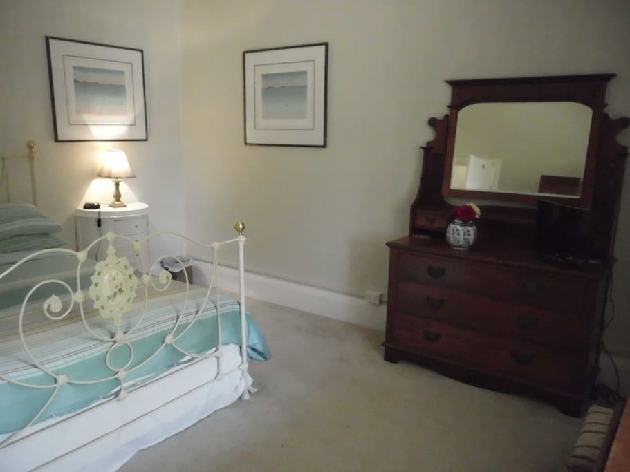 Your bedroom features antique furniture, as well as a TV/DVD player, heater and overhead fan.