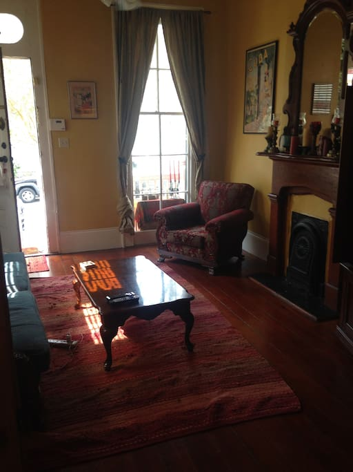 comfy couches and chairs reupholstered to match décor and style of 1870 house