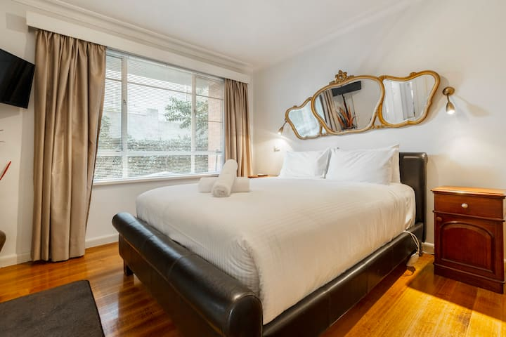 The first bedroom has a queen-sized bed and ample built-in storage space for your belongings.