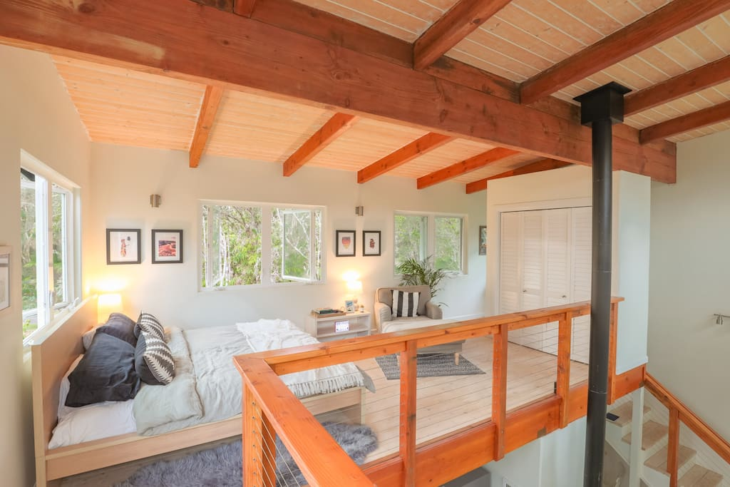 Open air loft on the 3rd floor, located at tree level with the Hawaiian Volcano Rainforest, enjoy high ceilings, plush king size bed, and large closest to store your belongings.