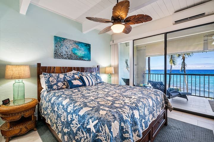 Master bedroom with full ocean view, floor to ceiling windows and a large sliding door so you can hear the waves and feel the ocean breeze while relaxing in bed!  Super high quality mattress and bedding.
