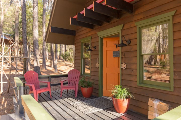 Sip your coffee on your front deck under towering trees