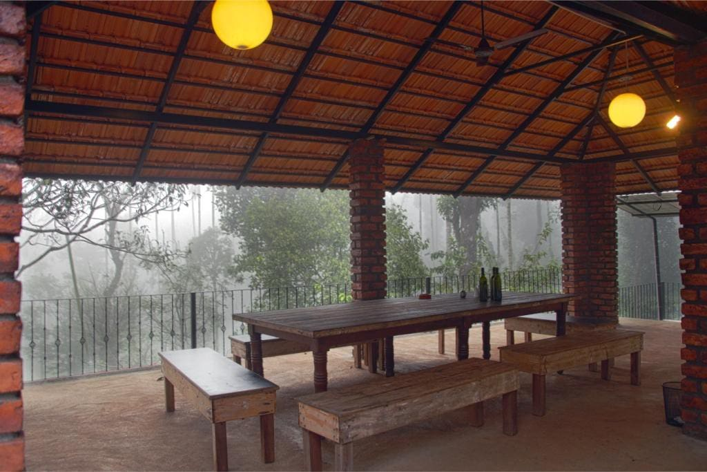 Terrace dining area in Whispering Trees