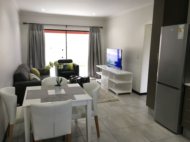 Neat & safe 2 bd room with uncapped WiFi and DStv