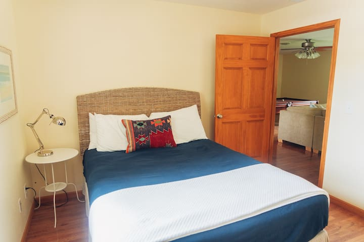 Third bedroom with queen sized bed and direct access to second floor bath with walk in shower.