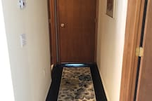 Hallway to bathroom with locked door to main home for safety and security.