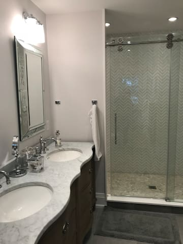 Master bathroom with two vanities and a large shower