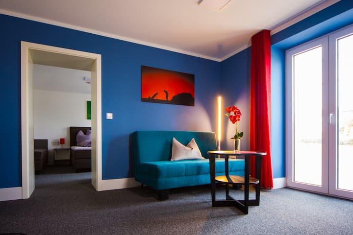 Appartements am Rindhof (Münnerstadt), Modernes Appartement 1 in ruhiger Lage mit Terrasse und Blick ins Grüne