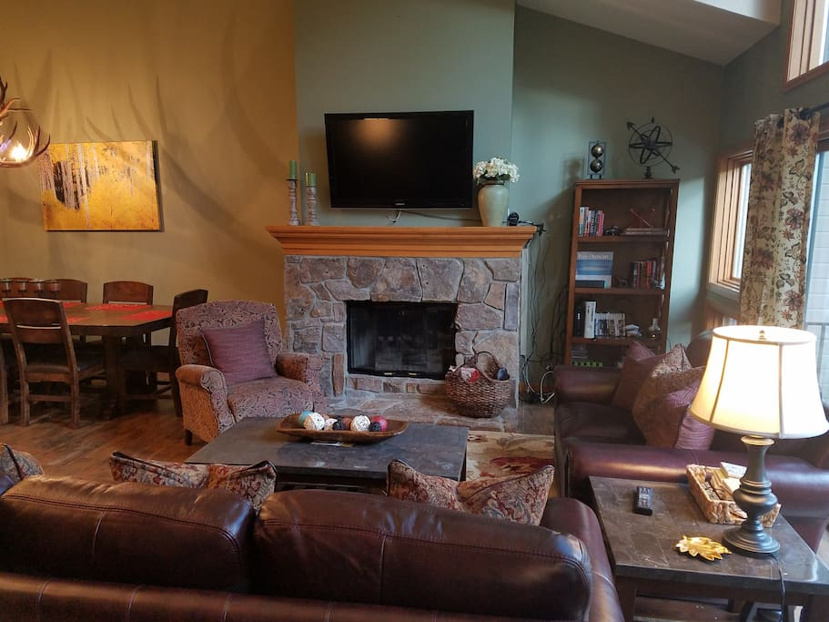 """Living room with full size leather sofabed, leather loveseat, 46"""" TV with cable, HBO, Xbox"""