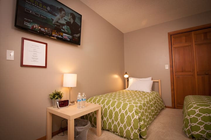 Bedroom # 1 in Fall, Winter & Spring. Set up for retreat groups with 3 single beds.
