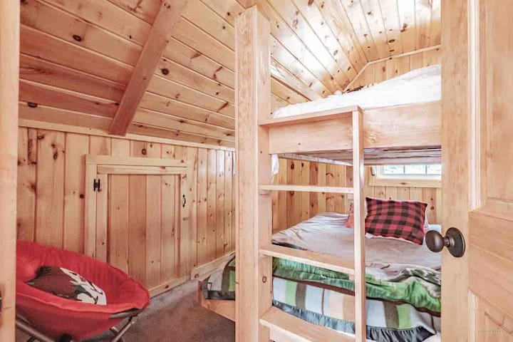 Bunk Room 2, Full bed on bottom, twin bed on top. Storage on the side walls.