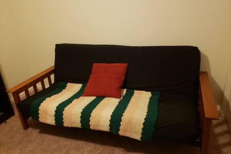 Single room w/ futon in family home