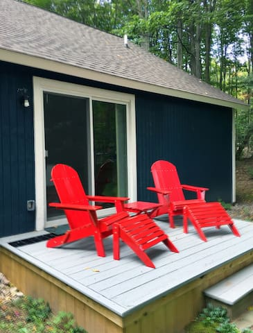 Private deck for the Banff Mountain sweet complete with Scarlett Adirondack Chairs- perfect for relaxing in the afternoon or stargazing at night. Recently spied two bald eagles soaring gracefully above the woods