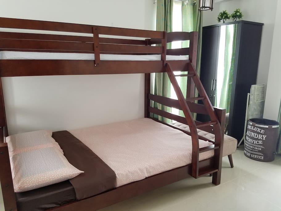 A single sofa bed can be made available for your extra child. It fits well under the full-size bed...