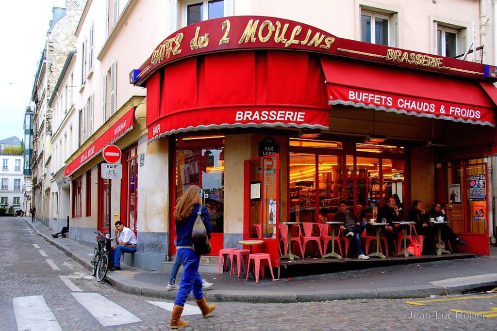 Downstairs from the apartment is the iconic cafe de deux moulins where Amelie was filmed