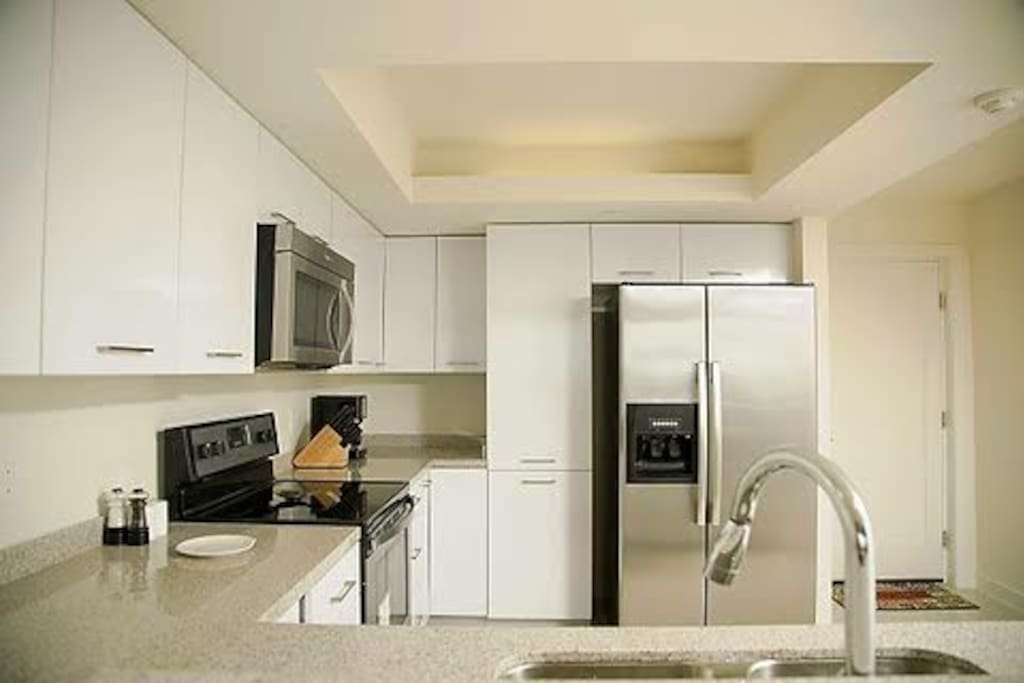 The kitchen is fully equipped and comes with modern stainless steel appliances, plenty of pots and pans, dishes and a full set of cooking utensils.