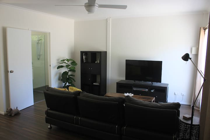 The apartment has an open plan living area,