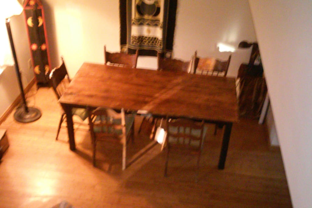 Cathedral ceiling dining area with Farm table