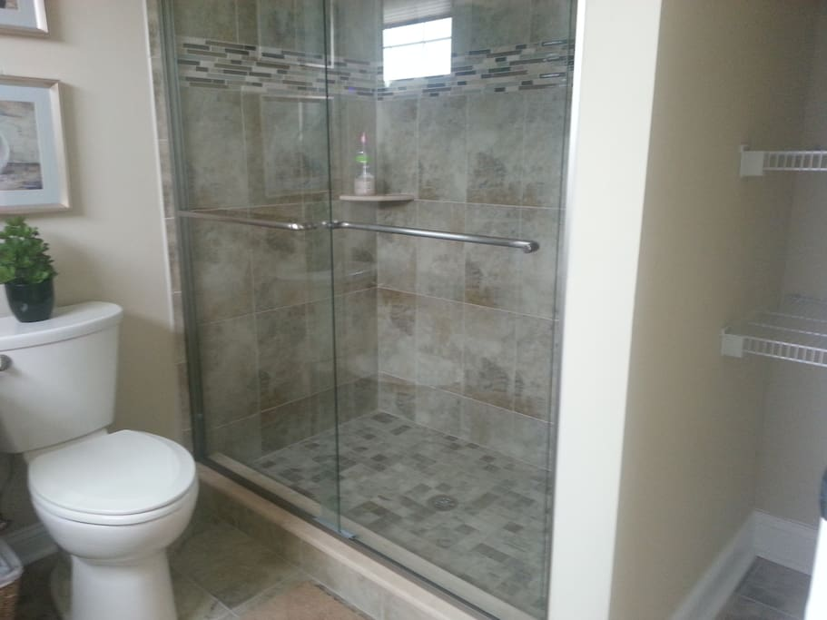 Master Bathroom with walk-in shower and linen area.