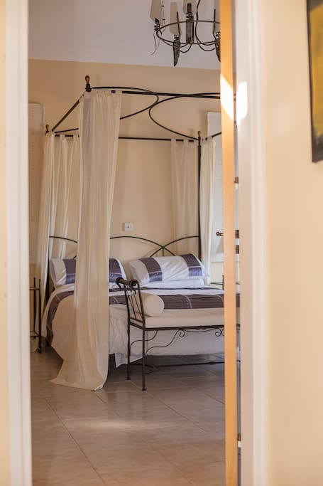 Romantic master bedroom with modern four poster bed