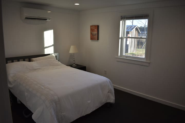 Master Bedroom with Queen size bed and own entrancce