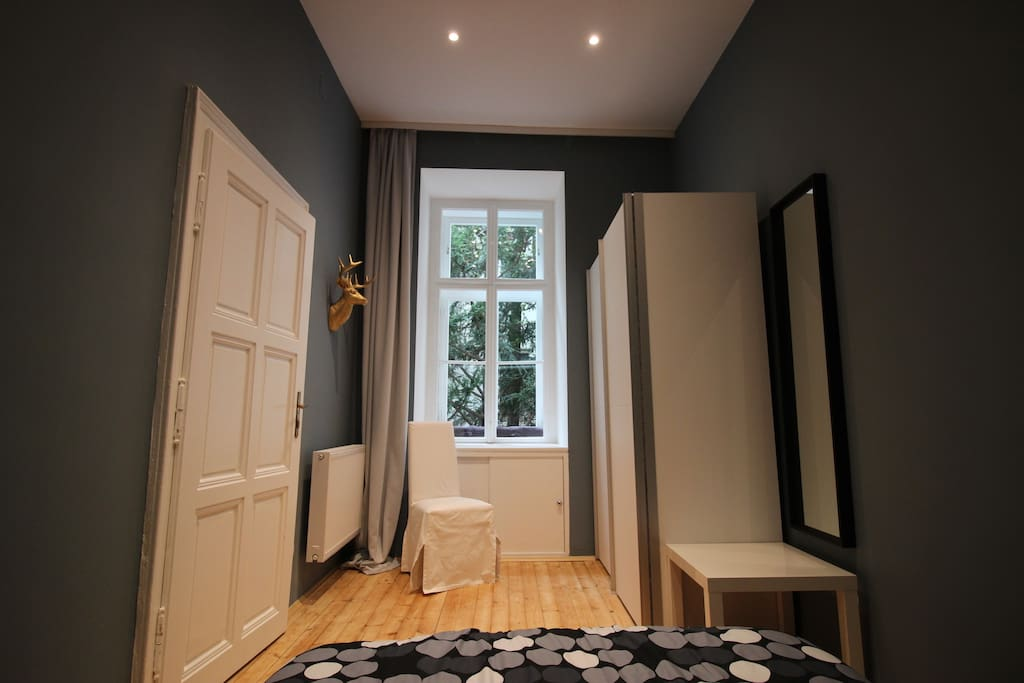 Bedroom with wardrobe and dressing mirror.