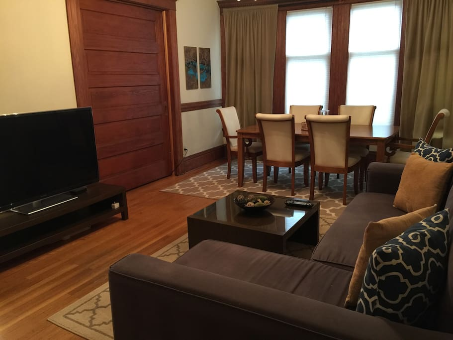 """55"""" TV in living room with full cable access, queen sofa sleeper, dining table for 6"""