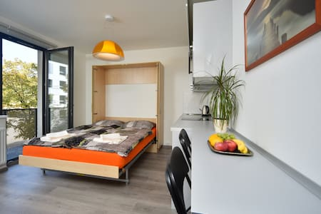 New design flat just next to subway! Free parking.