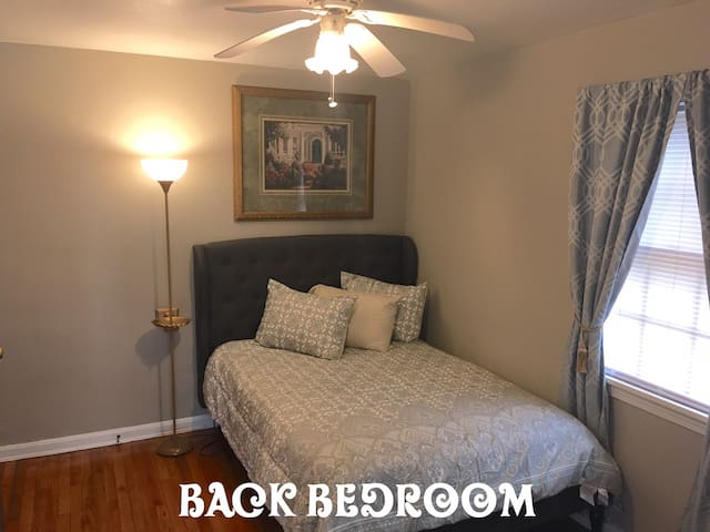 New tufted bed in back bedroom