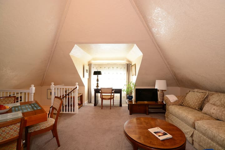 Live the good life... at beautiful attic apartment