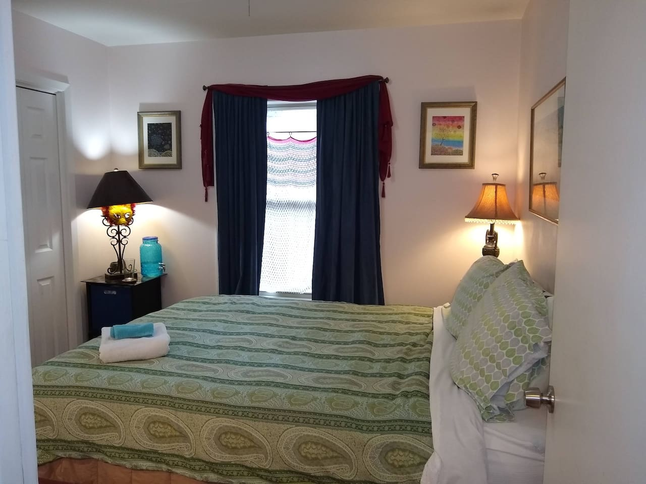 The COZY room is the middle bedroom and truly lives up to its name! It is 100 sft with a queen bed.  Blue, blackout curtains for those who like to sleep late. Water dispenser provided in each room.