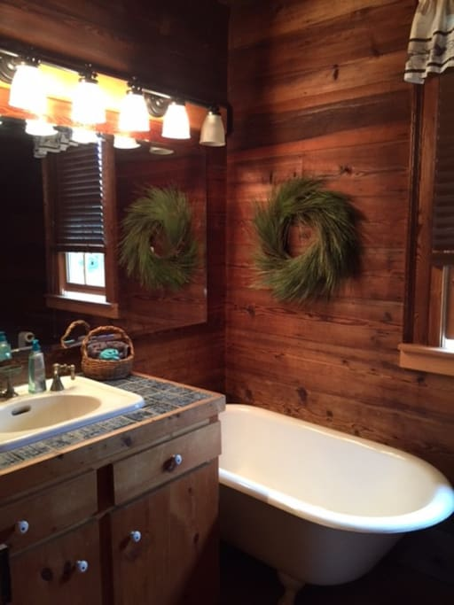 The upstairs bath has a modern shower, but also a period claw-foot tub!