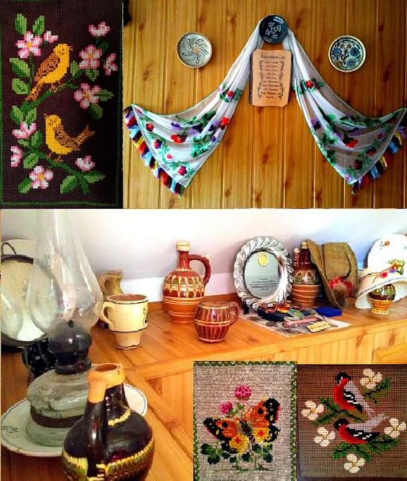 Traditional ornaments and pottery on display in the room.