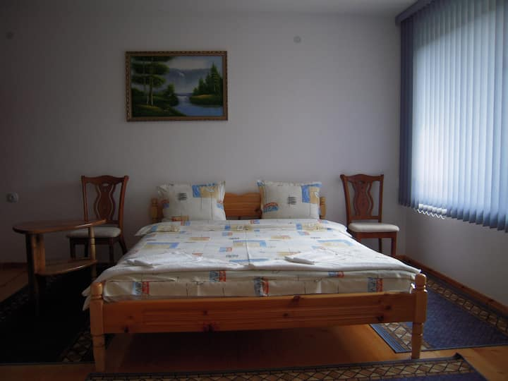 Room with double bed, balcony with mountain view