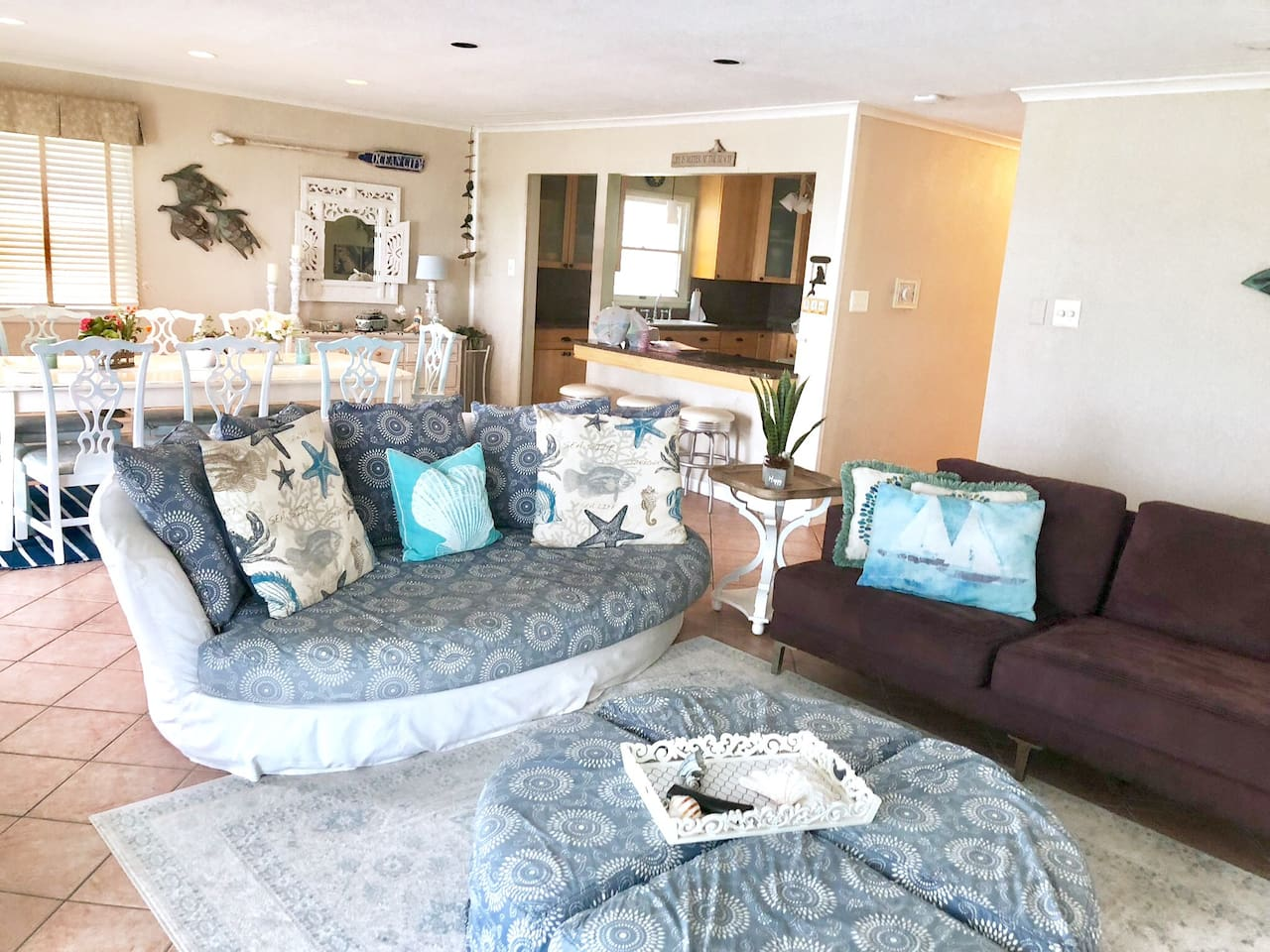 Extra Wide Living Room/ dining room / kitchen area keeps families gathered with its comfy couches, working fireplace,  60 inch flat screen TV with voice activated remote & games in the drawers!