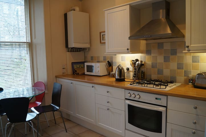 The spacious kitchen comes fully equipped with everything you could need for self catering