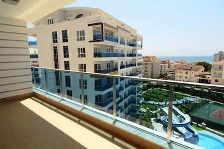 Новая квартира на берегу живописной горной реки. - Tosmur Belediyesi