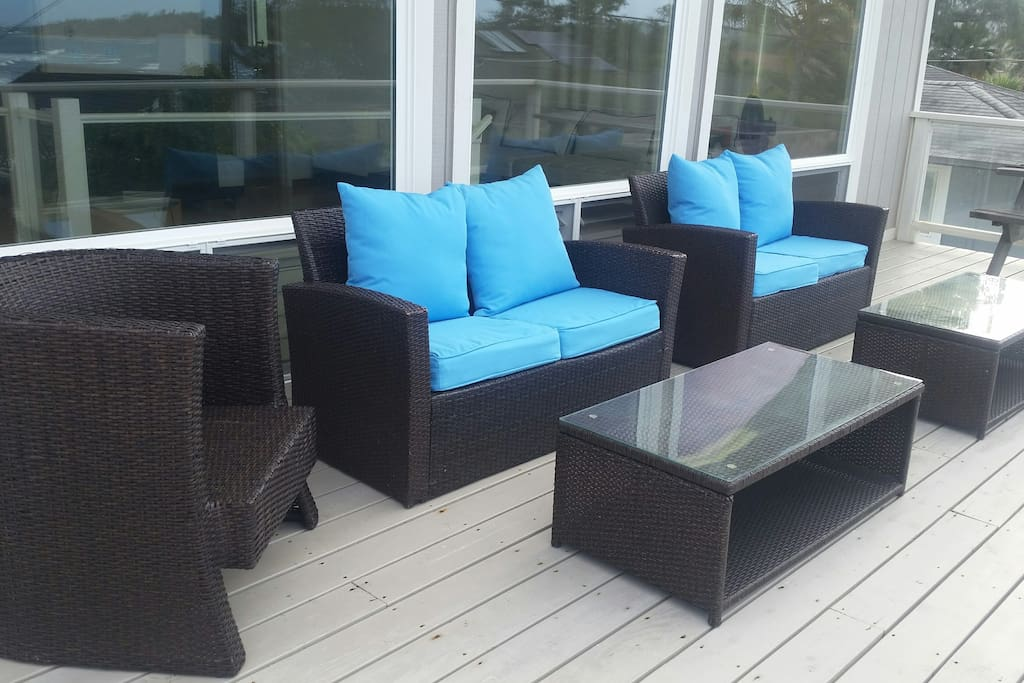 Put your feet up and relax on the upstairs lanai while you watch the ocean